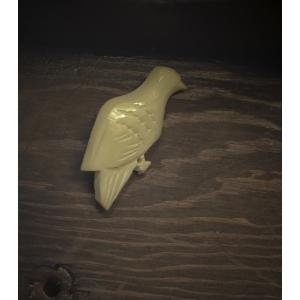 Broche met vogel