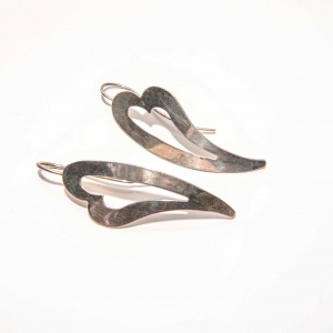 Vinatge oorstekers in abstracte hartvorm